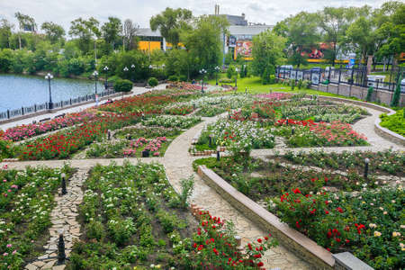 Rose garden in the city Park, public recreation area, pavement and accomplishment along the coastal area near the pond in the park in the city of Donetsk, Ukraine, Donetsk, June 2013 Editorial