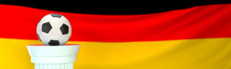 A football (soccer) ball stands on pedestal in front of Germany flag, 3D render illustration with depth of field
