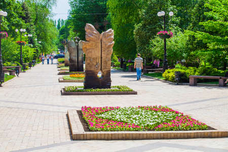 Flower bed and decorative statues in urban public place, Park infrastructure, editorial, Donetsk, Ukraine, May 2013 Editorial