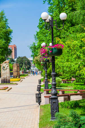 Flower pots on a lampposts in urban public place, Park infrastructure, editorial, Donetsk, Ukraine, May 2013