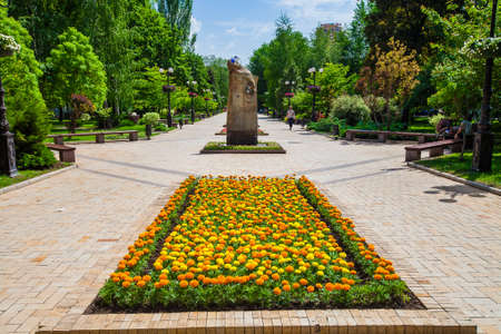 Flower bed in urban public place, Park infrastructure, editorial, Donetsk, Ukraine, May 2013