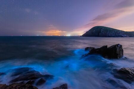 Seaside, beautiful starry sky and blue waves