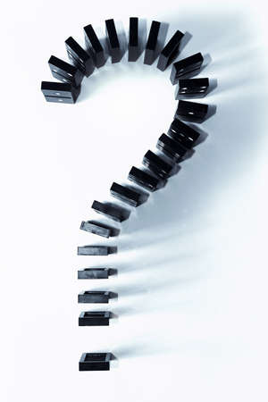 Pieces of domino in shape of question symbol. Top view. Stock Photo