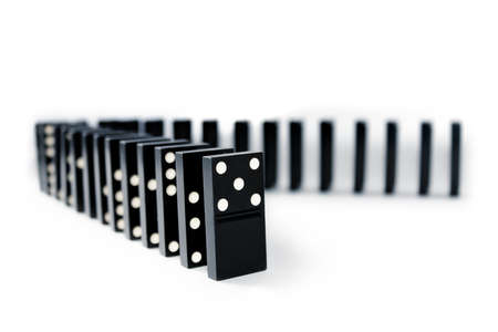domino pieces stand in a shape of corner. Isolated. photo