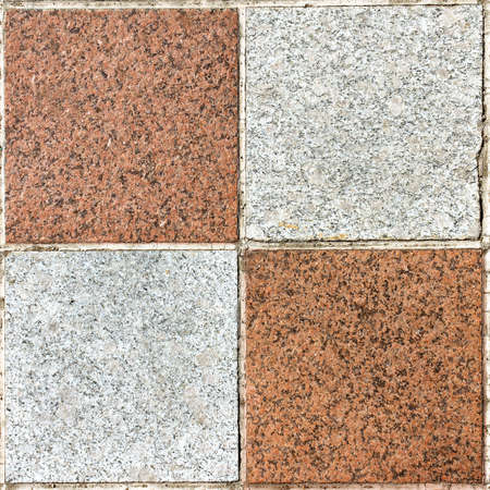 square texture of four marble white and brown tiles