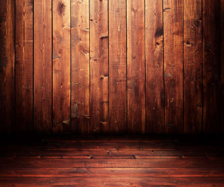 Grungy wooden room with a spot light