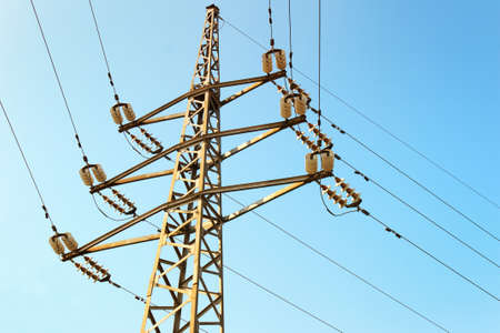 Power line on the clear blue sky background Stock Photo
