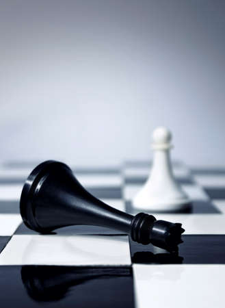 Chess king defeated by white pawn Stock Photo