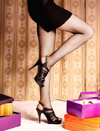 shoe box: Young woman buys shoes  Stock Photo