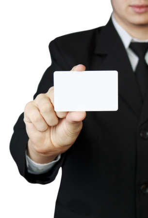 Businessman holding white card in hand Stock Photo
