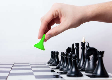 Man makes first step in chess Stock Photo
