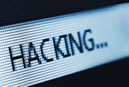 Macro photo of the word Hacking on LCD Stock Photo