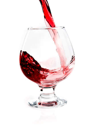 Glass with flowing wine isolated
