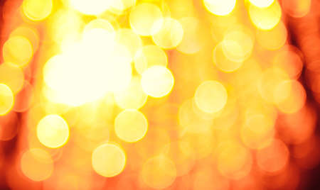 Abstract sunny bokeh on orange background Stock Photo