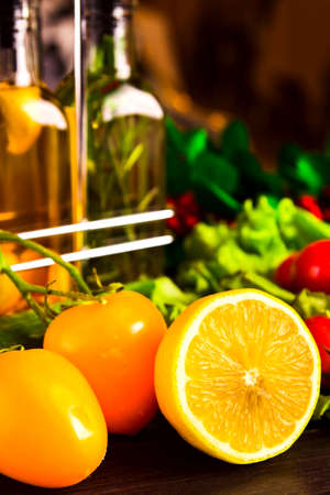 cooking table with lemon and tomato Stock Photo