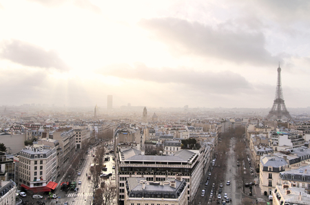 Panoramic view of Paris at warm sunrise with silhouette of Eiffel tower photo