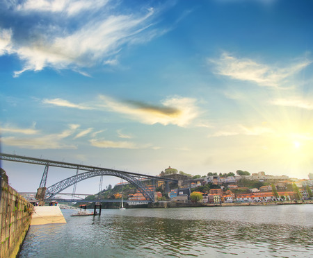 portugal: Colorful background, view of Douro riverside with the Dom Luiz bridge, Porto, Portugal. Travel background
