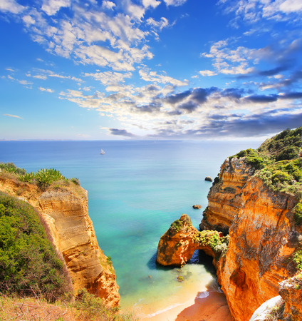 Rocky beach at sunset, Lagos, Portugal. Counter light. Travel and business background Zdjęcie Seryjne - 43704658