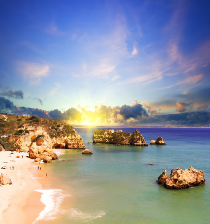 counter light: Rocky beach at sunset, Lagos, Portugal. Counter light. Travel and business background Stock Photo