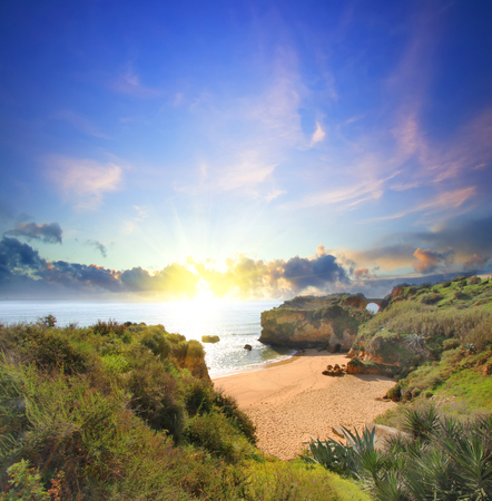 lagos: Rocky beach at sunset, Lagos, Portugal. Counter light. Travel and business background Stock Photo
