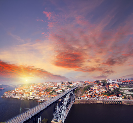 view of Douro riverside and the Dom Luiz bridge , Porto , Portugal. Colorful Travel background 版權商用圖片