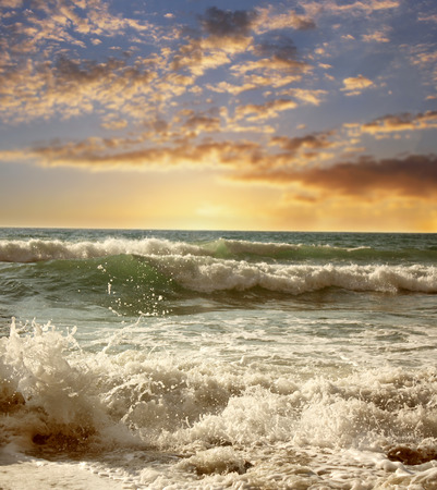 sunrise ocean: Seashore (beach) with the waves at sunset. Vintage Travel background