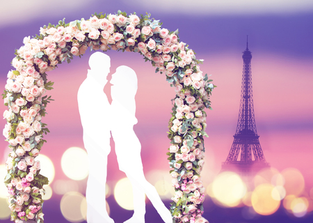 white silhouette of romantic lovers under the wedding arch with eiffel tower on a background in Paris, France