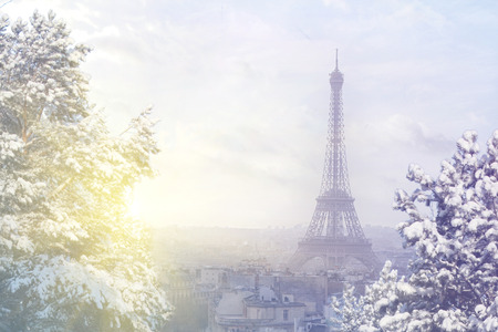 Christmas background: Aerial view of Paris cityscape with Eiffel tower at winter sunset in Paris. Vintage colored picture. Business, Love and travel concept