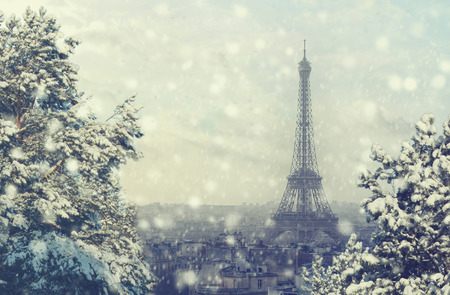 Christmas background: Aerial view of Paris cityscape with Eiffel tower at winter sunset in France. Vintage colored picture. X-mas, Business, Love and travel concept Фото со стока