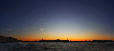 Classic panoramic view of Saint-Petersburg (St.Petersburg) river scape at sunset. Spit of Vasilyevsky Island. Neva River. winter palace. Travel background