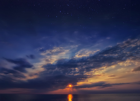 Beautiful sunset sky with stars and clouds. Natural background