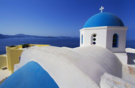 Blue and white colours of Oia City, Santorini, Greece Фото со стока