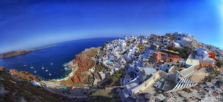 Magnificent panorama of the city of Santorini during the beautiful sunrise of the Mediterranean. Love and travel background Фото со стока