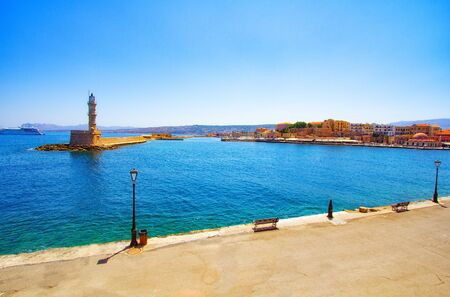 Lighthouse and bay of Chania at summer, Crete, Greece. Travel background