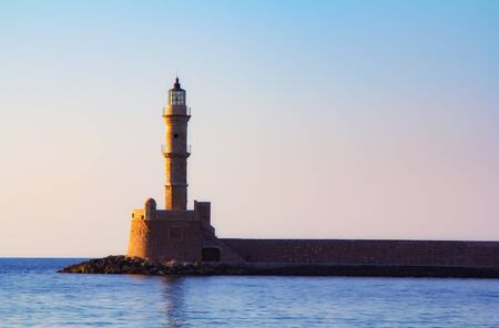 Lighthouse of Chania at summer sunset, Crete, Greece. Travel background Zdjęcie Seryjne - 128231213