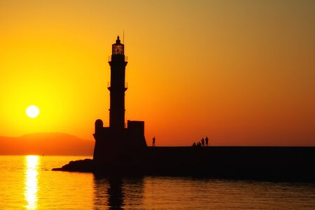 Lighthouse of Chania at summer sunset, Crete, Greece. Travel background