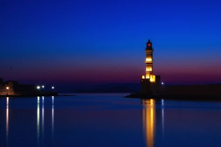 Lighthouse of Chania at summer sunset, Crete, Greece. Travel background Фото со стока - 128231222