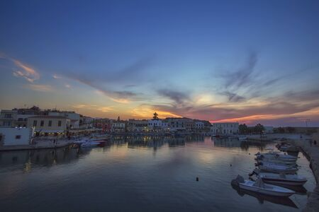 Sunset in the Mediterranean, Retimno, Crete, Greece. Love and travel background Фото со стока