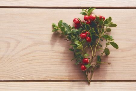 lingonberry  ( cowberry , partridgeberry ) on a wooden table. Top view Zdjęcie Seryjne