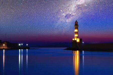 Galaxy over the Lighthouse of Chania at ummer sunset, Crete, Greece.