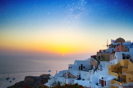 Magnificent view of the city of Oia on the island of Santorini Greece during a beautiful sunset in the Mediterranean. Love and travel background. Фото со стока