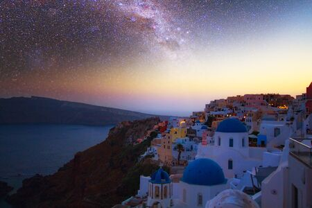 Magnificent view of the city of Oia on the island of Santorini Greece during a beautiful sunset in the Mediterranean. Love and travel background. Elements of this image furnished by NASA.