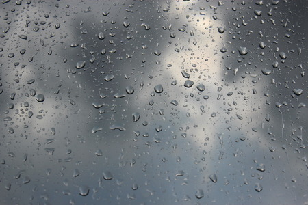 dullness: Drops of the rain on the window  Stock Photo