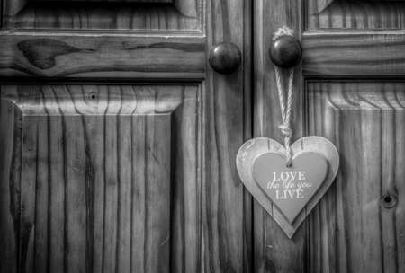 closet door: Love the life you live wooden heart on old rope string strap on closet wooden door