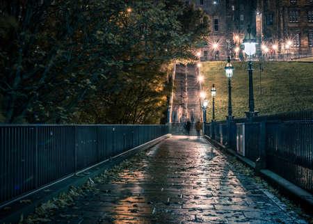 cross street: Narrow dark street with ghosts