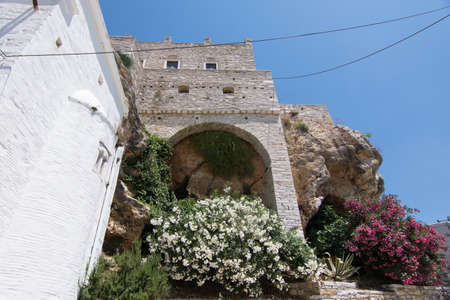 Wall on a cliff in Apiranthos, the marble village in Naxos, Greece