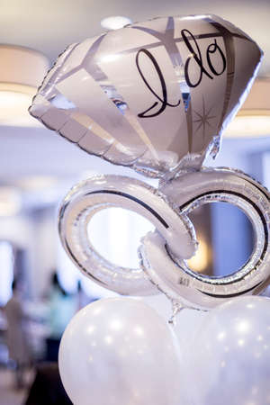White and silver mylar engagement balloon that says,