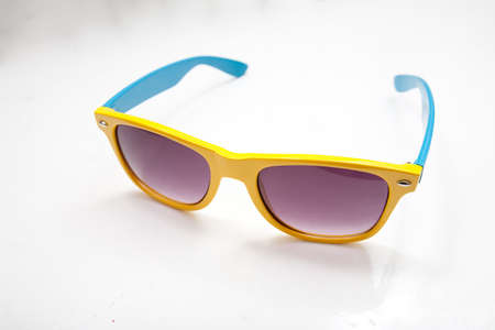 Close-up on colorful sunglasses on the white background photo