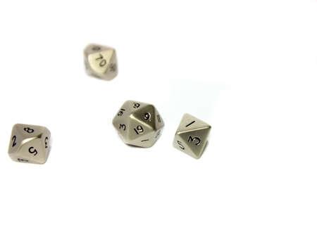 白い背景の上の小さな金属のサイコロ 写真素材