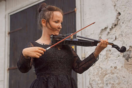 Beautiful young woman playing violin